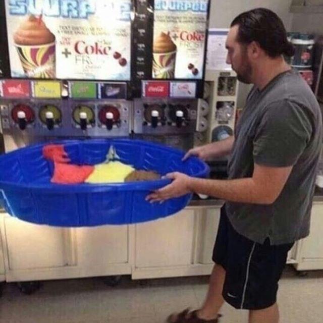 cursed image of person holding large tub under slurpie machine