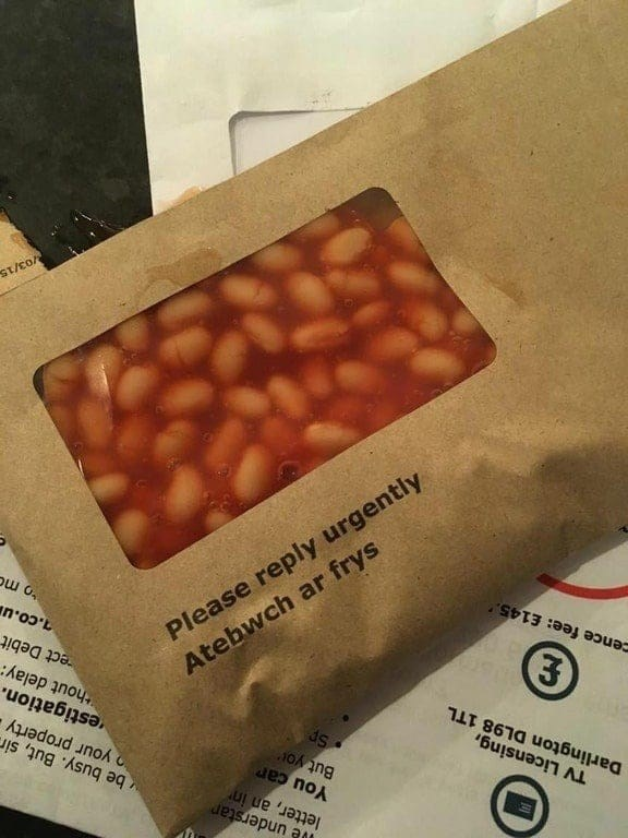 cursed image of sealed envelope filled with beans
