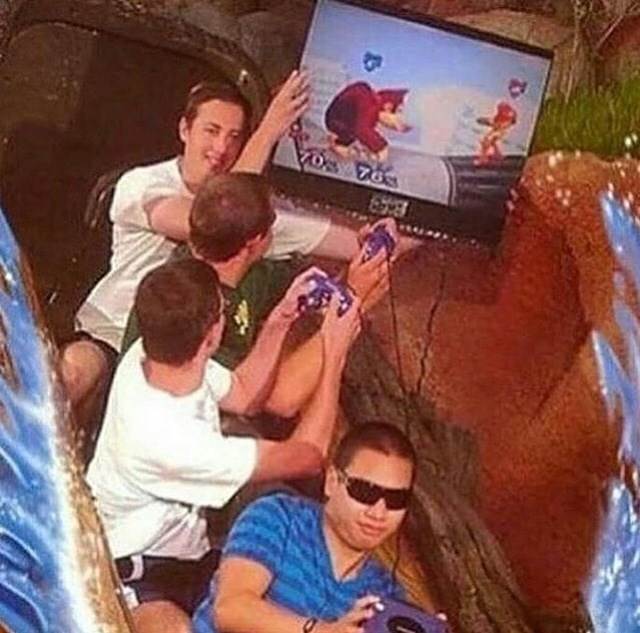 cursed image of people on Splash Mountain ride holding TV and controllers and playing video games