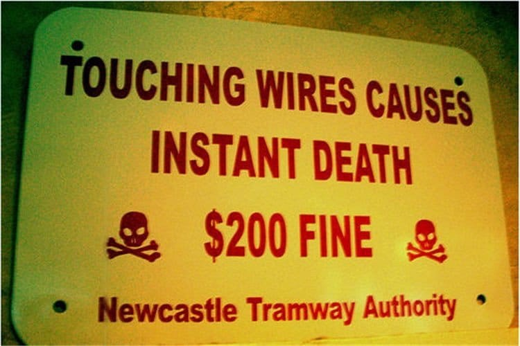 Text - TOUCHING WIRES CAUSES INSTANT DEATH $200 FINE Newcastle Tramway Authority