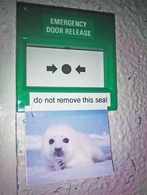 sign to not remove a seal for an emergency handle next to a picture of a baby seal