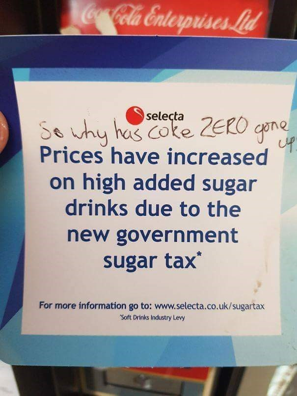sign on a vending machine asking why coke zero has gone up if only sugar drinks get taxed