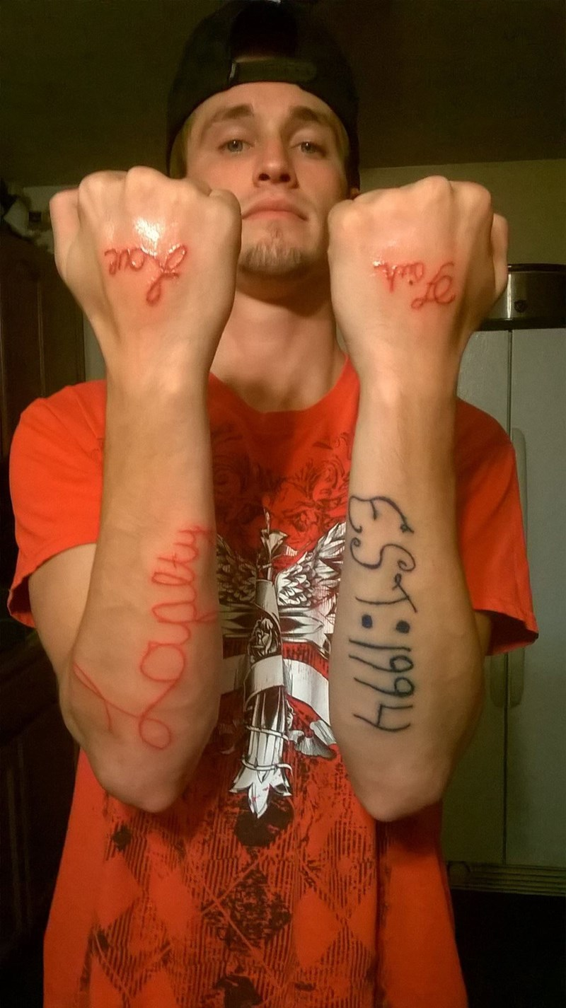 tattoo fail of words that are in script but it's not legible