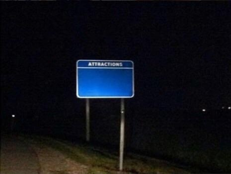 cursed_image - Street sign - ATTRACTIONS