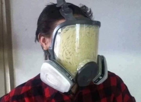 cursed_image - Gas mask filled with pasta