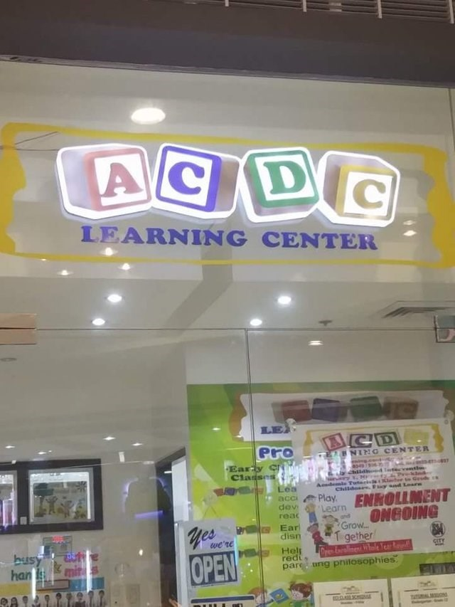 Building - ACDC LEARNING CENTER ACD Pro 2BNIN:G CENTER Eary CN Cladses hild 4 t Ged demle Tuterissla Childes Fgr nd Learn Lea acc dev Play ENROLLMENT GrowONGOING T gether Dr mne Year R pare ung pnitosophies Learn reac and yes Ear disn we're busy han is Hel red CITY OPEN ECLOC mALMONd