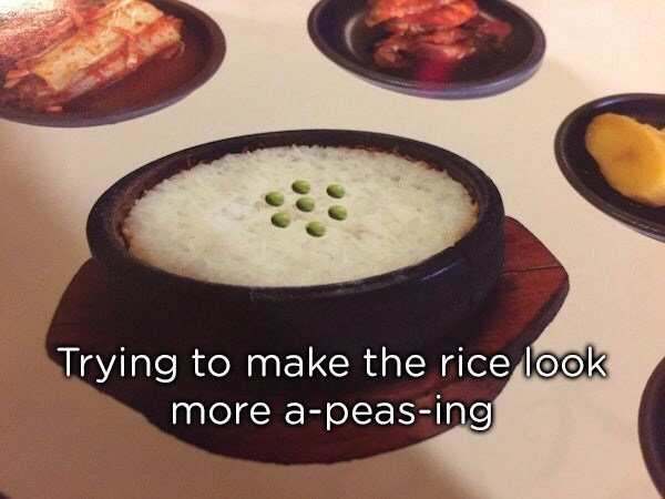 Photoshop fail of a bowl of rice and scattering of peas to look more A-PEAS-ING