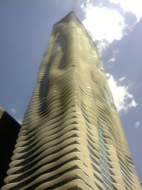 picture of Aqua at Lakeshore East Apartments building that looks like it's covered by foamy substance