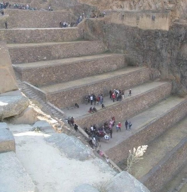 picture of people standing on large stone terraces that look like a giant staircase