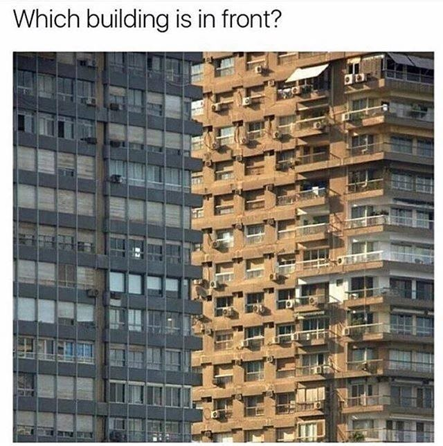 weird perspective picture of two building where you can't tell which one is closer to the camera
