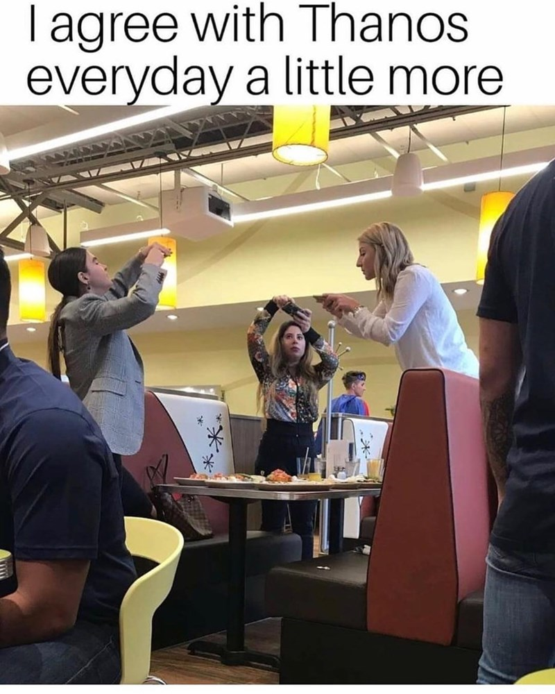 Funny meme about Thanos being right, photo of three women taking pictures of their food