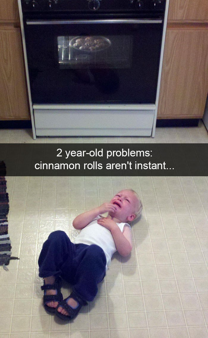 "Snapchat text overlay that reads, ""Two-year-old problems: cinnamon rolls aren't instant..."" over a pic of a toddler having a meltdown"