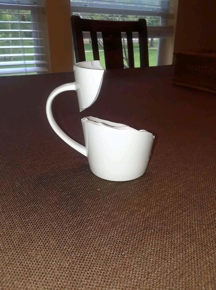 pic of a broken mug defying gravity