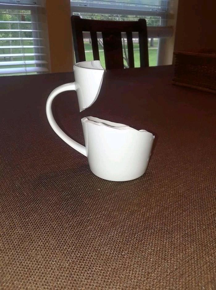 pic of a broken mug defying gravity