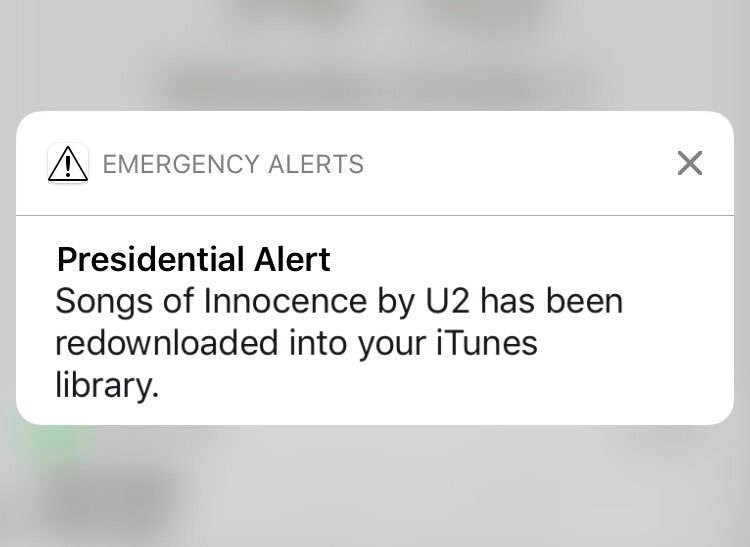 Text - X EMERGENCY ALERTS Presidential Alert Songs of Innocence by U2 has been redownloaded into your iTunes library.