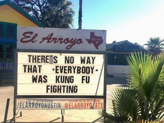 funny sign - Property - El Arrays austin ElArege THERE'S NO WAY THAT EVERYBODY WAS KUNG FU FIGHTING LIKE US ON FACEBOOK FOLLOW US ON INSTAGRAM /ELARROYOAUSTIN @ELARROYO ATX