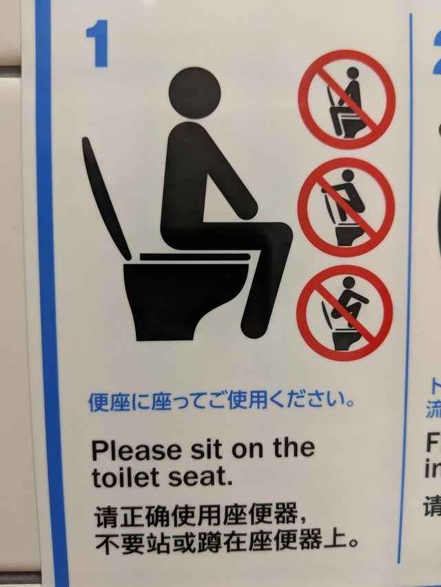 funny sign - Sign - 1 便座に座ってご使用ください。 Please sit on the toilet seat. in 请 请正确使用座便器, 不要站或蹲在座便器上。 ト 流 F.m