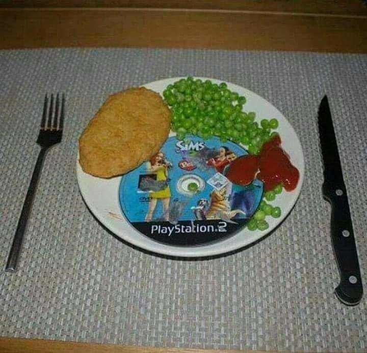 Cursed Image of a plate of food with sims in the middle of it