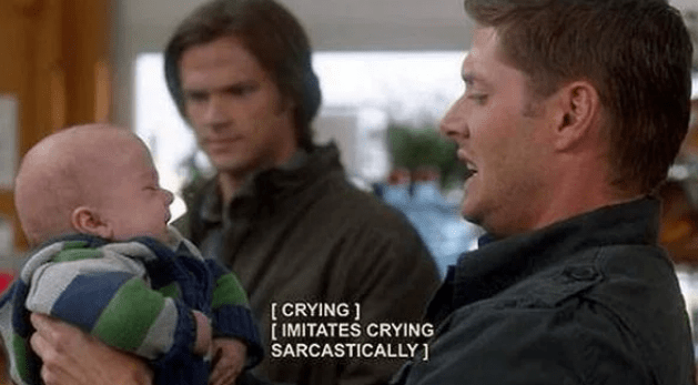 Dean from Supernatural holding up crying baby and crying back at it