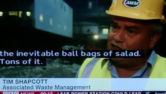 man in safety jacket and yellow helmet discussing salad on the news