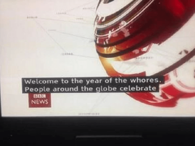"""subtitle fail in BBC news broadcast welcoming you to the """"year of the whores"""""""