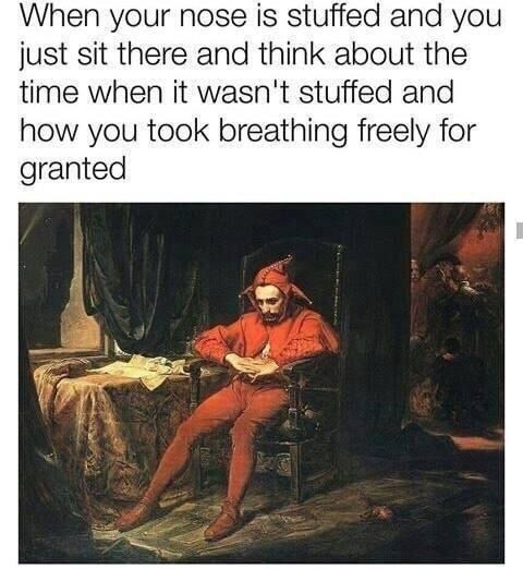 """Caption that reads, """"When your nose is stuffed and you just sit there and think about the time when it wasn't stuffed and how you took breathing freely for granted"""" above a painting of a guy in a joker costume sitting in a chair looking sad"""