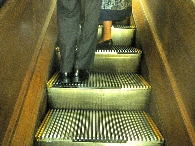 Pic of a guy standing on the left side of the escalator