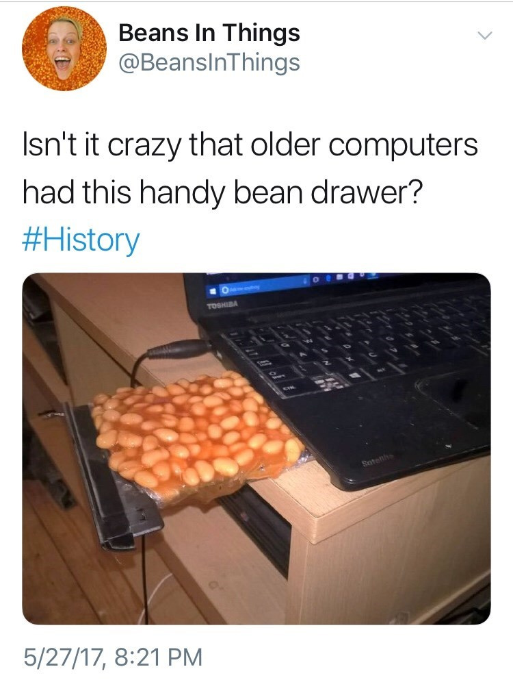 tweet about using the cd slot in a computer to put beans in it