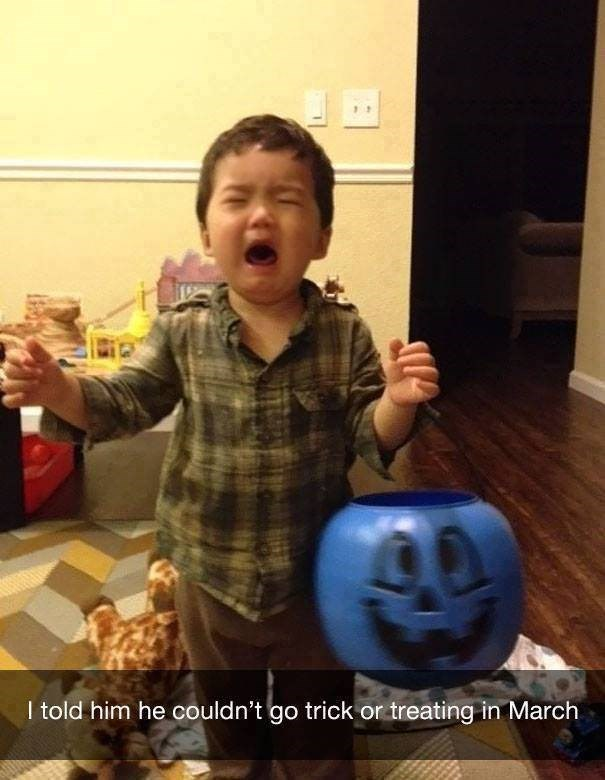parenting meme of a toddler holding a pumpkin waiting to collect candy but not being able to because its march