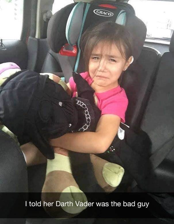 parenting meme of a girl crying while holding Darth Vader after hearing he is evil