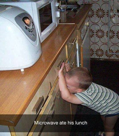 parenting meme of a kid looking distraught while standing in front of the microwave and thinking it ate his food