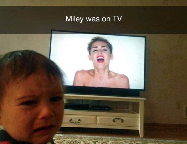 parenting meme of a toddler crying while watching miley cyrus on tv