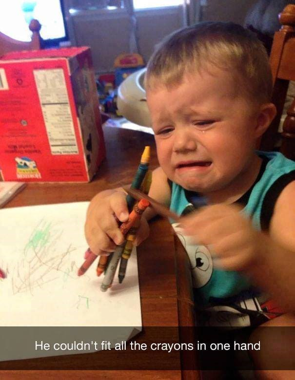 parenting meme of a little boy crying and holding a bunch of crayons in one hand
