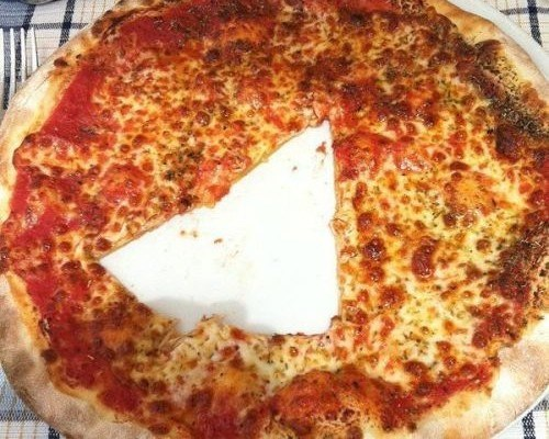 cursed_image - slice of pizza cut out in the middle of the pie