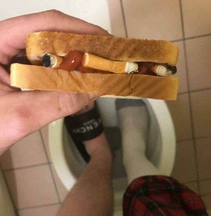 cursed_image - sandwich filled with cigarettes and random stuff