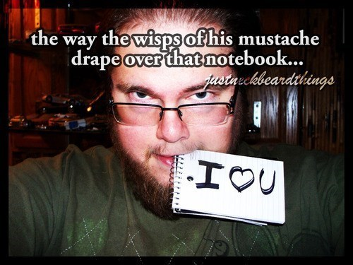 photo of man holding I love you note in mouth with the caption the way the wisps of his mustache drape over that notebook
