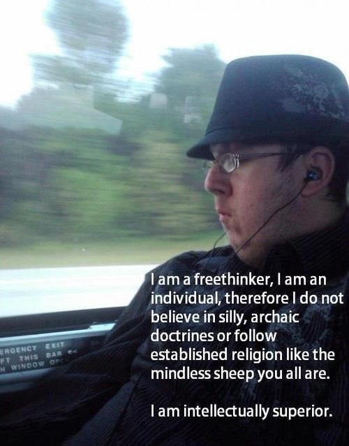 photo of fedora wearing man in moving train with caption explaining he's a free thinking Atheist who is intellectually superior