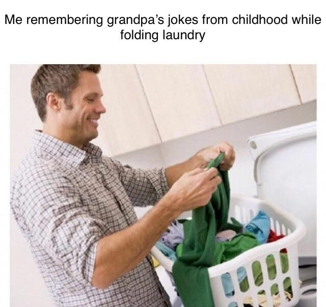 "Caption that reads, ""Me remembering grandpa's jokes from childhood while folding laundry"" above a stock photo of a guy folding his laundry"