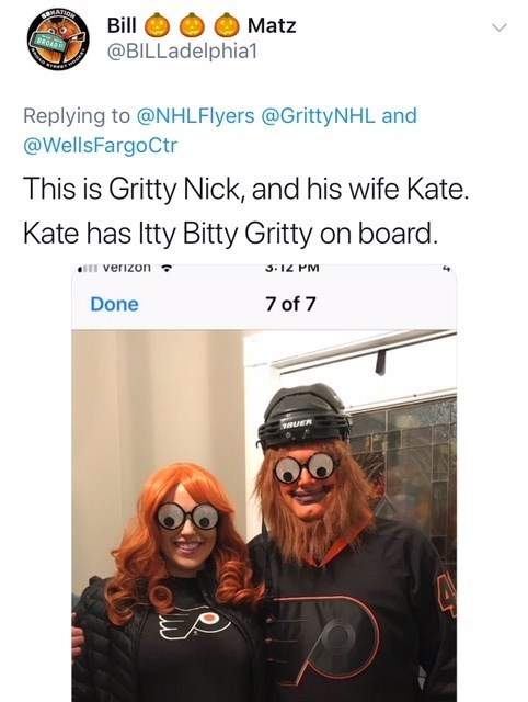 couple with orange hair and googly eyes dressed as Gritty the mascot for Halloween