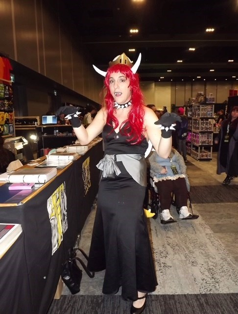 woman in red wig and horns dressed as Bowsette meme for Halloween