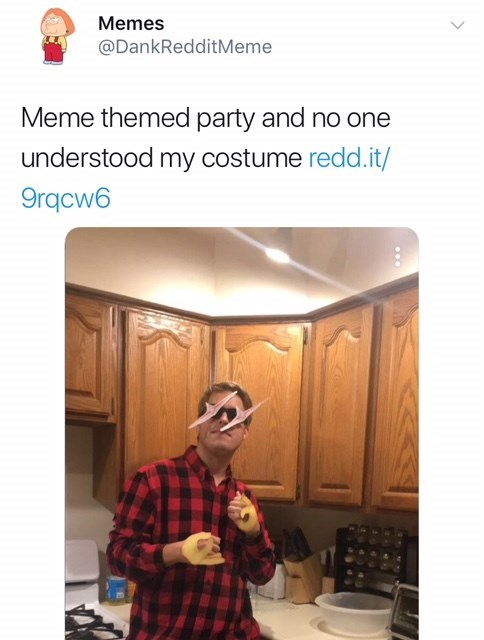 man in meme themed costume with glowing eyes and ok sign hands