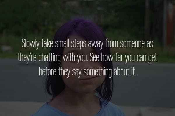 text about taking small steps away from someone while they chat to you over picture of purple haired woman