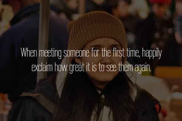 text about meeting someone for the first time and telling them it's great to see them again over picture of woman looking confused wearing beanie