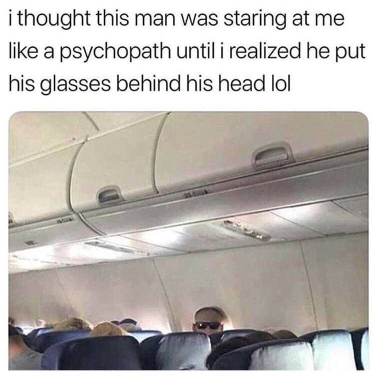 Tweet about thinking man is staring at you like psychopath with picture of man on plane wearing glasses behind head