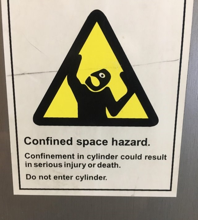 Sign - Confined space hazard. Confinement in cylinder could result in serious injury or death. Do not enter cylinder.