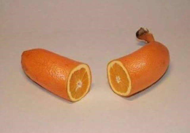 picture of cut up orange shaped like banana