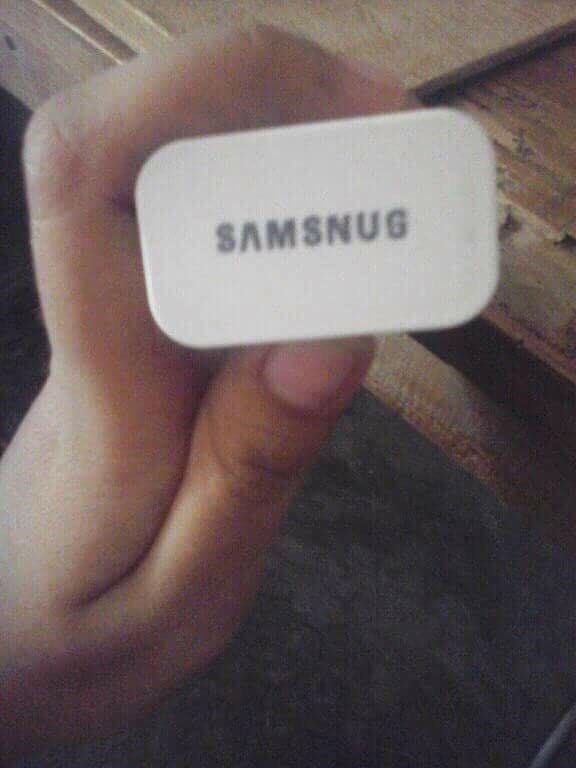 "picture of phone charger showing the text ""samsnug"""