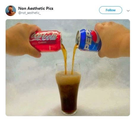 picture of hands pouring Pepsi and Coke into the same glass
