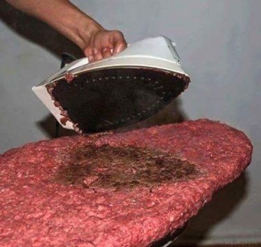 picture of giant meat patty being ironed on ironing board