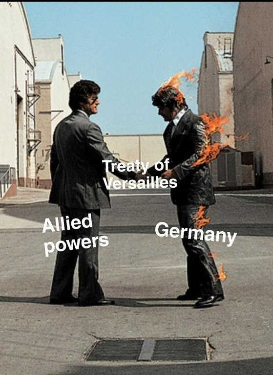 fake history meme about treaty of Versailles with picture of man shaking hands with burning man